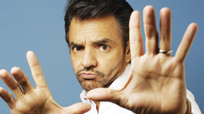 """In this Thursday, Sept. 5, 2013 photo, Mexican actor Eugenio Derbez poses for a photo during an interview in Los Angeles. Derbez starred, directed and wrote the Spanish language independent film, """"Instructions Not Included."""" (AP Photo/Damian Dovarganes)"""