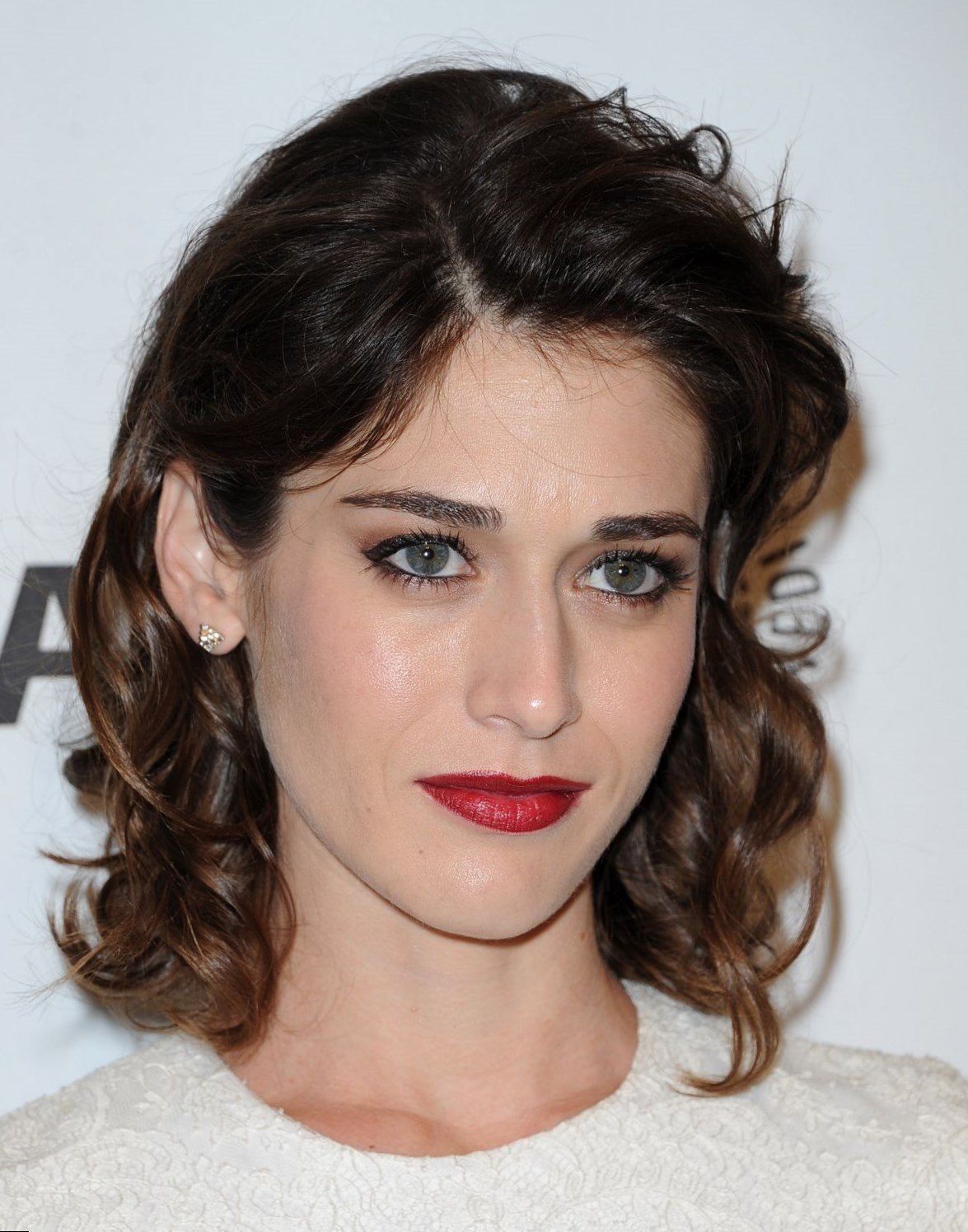 Lizzy caplan love is the drg