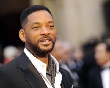 """FILE - In this March 2, 2014 file photo, Will Smith arrives at the Oscars at the Dolby Theatre in Los Angeles. Smith, Jared Leto and Tom Hardy are suiting up for DC Comics' supervillain team-up film """"Suicide Squad."""" Warner Bros. confirmed the much anticipated casting of the film in an announcement Tuesday, Dec. 2, 2014.  (Photo by Chris Pizzello/Invision/AP, File)"""