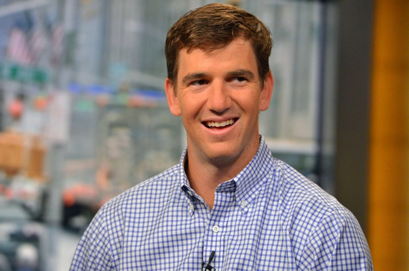 Eli Manning's eyes and hair color